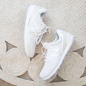 New Balance 696 Cream Sneakers